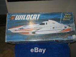 Classic vintage mini wildcat r/c boat set, original box, sold for PARTS